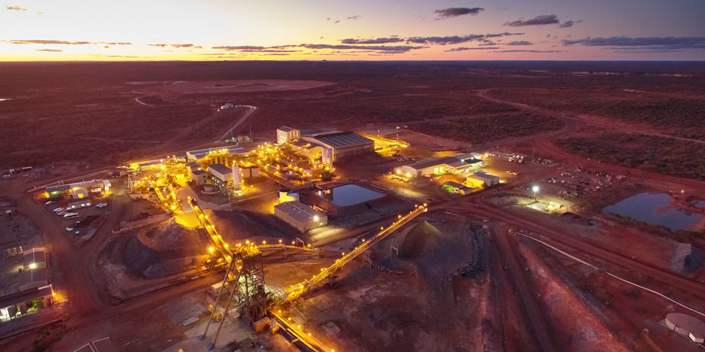 Aerial view of Golden Grove site lit up at sunset