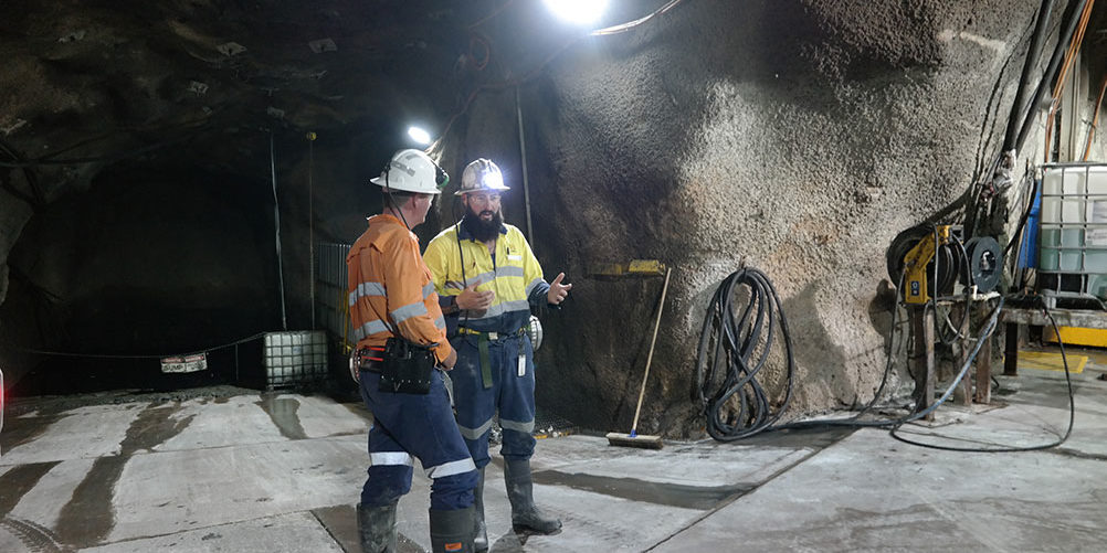 Two miners working together underground at Gwalia Deeps